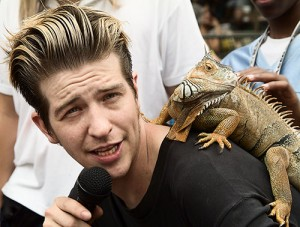 Dylan Studebaker with his lizard at Toronto's Busker Festival